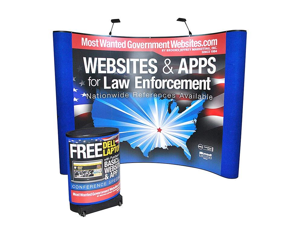 Most Wanted Government Websites - Exhibit Booth - 10 ft Curve Wall & Shipping Case Podium Conversion